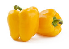 Two yellow peppers on white background. Two ripe yellow peppers on white background Royalty Free Stock Photo
