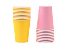 Two yellow and pink stacks of paper cups Stock Photos