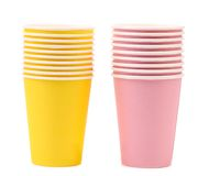 Two yellow and pink stacks of paper cups. Royalty Free Stock Photo