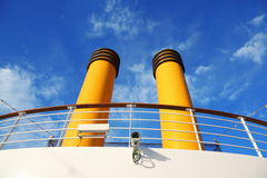 Two yellow pipes on big cruise ship. Royalty Free Stock Images