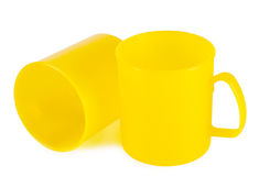 Two yellow plastic cups Royalty Free Stock Photos