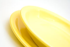 Two yellow plates Stock Image