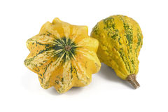 Two Yellow Pumpkins. Two yellow ornamental pumpkins over white background Stock Photo