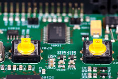 Two yellow pushbutton on a circuit board Stock Image