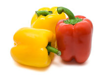 Two yellow and red bell peppers Stock Image