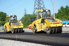 Two yellow rolling machinery Stock Images