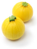 Two yellow round zucchini Royalty Free Stock Photos