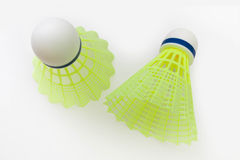 Two  yellow shuttlecock against Royalty Free Stock Photos