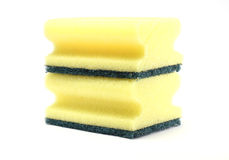 Two yellow sponges. Isolated on white background royalty free stock images