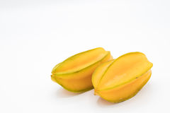 Two yellow star apple fruit or carambola on white background Royalty Free Stock Images