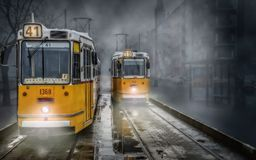 Two yellow streetcars trams at the terminus Royalty Free Stock Photography