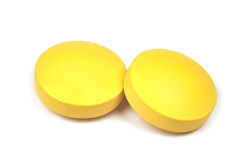 Two yellow tablets Stock Image