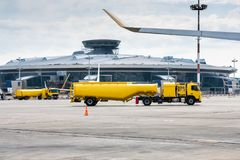Two yellow tank truck aircraft refuelers. At the airport apron Royalty Free Stock Photo