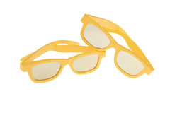 Two yellow three-dimensional movie glasses. Isolated on a white background Stock Image
