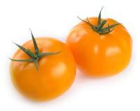 Two yellow tomatoe Royalty Free Stock Photo