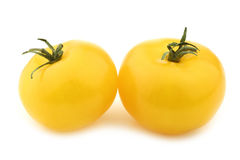 Two yellow tomatoes Stock Photos