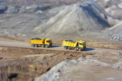 Two yellow trucks in a coal mine Royalty Free Stock Photography