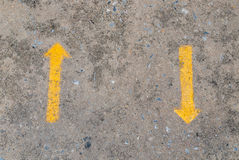 Two yellow way arrow pointing in opposite directions symbol Royalty Free Stock Photo