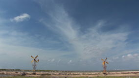 Two yellow windmills on Bonaire. Yellow windmills at work on the Dutch Caribbean island of Bonaire stock video footage
