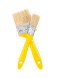 Two yellows paintbrushes Royalty Free Stock Image