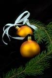 Two yelow christmas balls Stock Photos