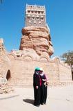 Two yemeni girls in front of Dar al-Hajar, Dar al Hajar, the Rock Palace, royal palace, iconic symbol of Yemen Stock Image