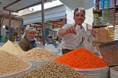 Two yemeni men in the salt market of the Old City of  Sana'a, suq, Yemen, sellers, spices, saffron, daily life. The Old City of Sana'a, the oldest continuously Royalty Free Stock Images
