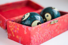 Two ying - yang balls in red box Royalty Free Stock Images
