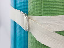 Two yoga mats  white belt Royalty Free Stock Image