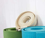 Two yoga mats  white belt Royalty Free Stock Images