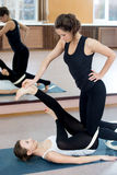 Two yogi female practicing yoga therapy in class Royalty Free Stock Photo