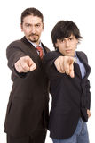 Two on you. Two young business men selecting you with finger Royalty Free Stock Images