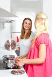 Two youn women in the kitchen Stock Photo
