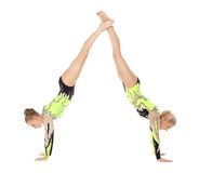 Two young acrobats woman stand on hands Stock Image