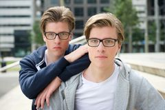Two young adult brothers Stock Photo
