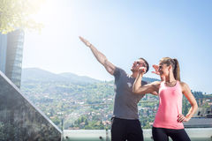 Two young adult fitness models posing on rooftop. Stock Photo