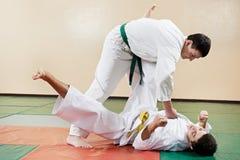 Two man at taekwondo exercises Stock Images