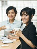 Two young adults smiling with coffee Stock Images