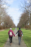 Two young adults walking together Stock Photo