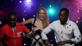 Two young African American men dance with stylish girls. Two young African American man dancing with girls. In the center of blond girl. Synchronous movements stock video