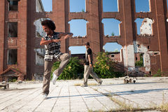 Two young African American men street dancing Royalty Free Stock Image