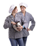 Two young apprentice cooks Stock Photos