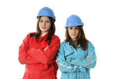 Two young apprentices with helmets and coveralls Stock Image