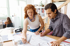 Two young architects in office Royalty Free Stock Photo