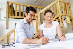Two young architects in office Stock Images