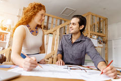 Two young architects in office Stock Image