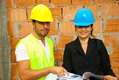 Two young architects on site Stock Images