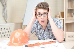 Two young architectures working at projective Royalty Free Stock Photography