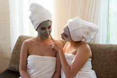 Two young asia happy women with face masks stock images
