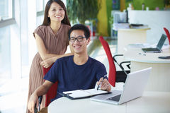 Two young asian businesspeople in office Stock Photos